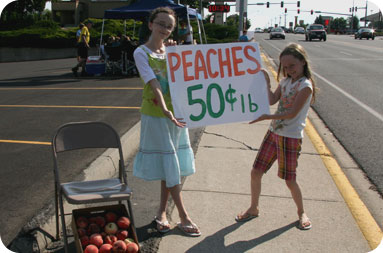 Girls selling peaches